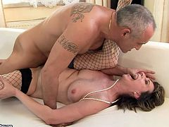 Mature slut in fishnet stockings loves a good, hard fuck! She rides her lover's dick cowgirl style. Then she gets into sideways position to let him control the penetration. He pounds her mercilessly in and out loosening up her once tight pussy.