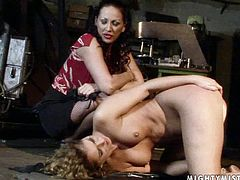 Curvy dark haired chic sits on her ass finger fucking her soaking cunt before she is forced to stand in doggy pose to drill her snatch with a dildo under control of experienced domina.