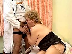 Fat blonde granny Leila is getting naughty with some guy indoors. She sucks his dick ardently and then welcomes his prick in her hairy meaty butt.