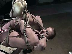 This busty and sexy blond siren is being tortured so fucking hard! She gets tied up and then her mistress makes a lot of fun of her!