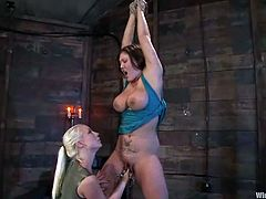 Claire Dames is getting naughty with blonde mistress Lorelei Lee in a basement. Lee plays with Claire's big natural boobs and then fucks her snatch with her fist and a dildo.