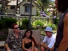 Wondrous sunbathed brunette with sweet boobies spreads legs while sitting on the deck chair. Long haired dude eats her juicy pussy and gets a stout blowjob in return right outdoors.