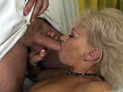 Slutty mom is sucking cock deepthroat while getting nailed bad in her cunt. Then another two aroused men enter the room joining the action. So she is now surrounded by a bunch of horny studs. They all thrust their hard dongs in her face so she sucks them one after another.