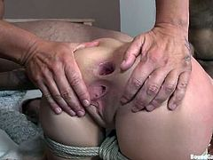 Babe gets down on all of them and gives them some nice blowjob. Then they bondage her and penetrated her pussy and asshole at the same time, sticking one in her mouth too!