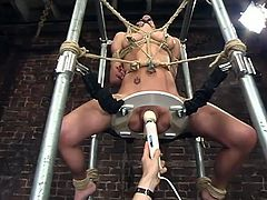 So she gets some bondage session first. But it is just a warm up. Then honey gets tied up on the wooden device, which has s dildo shifting deep in her twat!