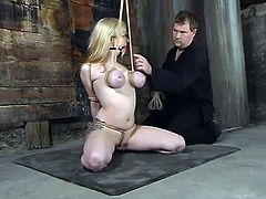 The hot blonde Adrianna Nicole is getting severely tied up in this wild bondage and domination video with torture and hot toying action.