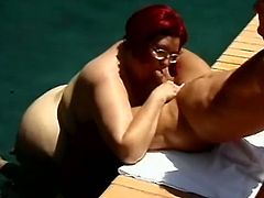 BBW mature slut Sindee Williams with glasses sucking cock near a pool and getting hot cum from horny BBW lover. She has some huge tits.