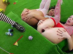 Our girls love to play games and to get their assholes stretched, so why not do both? Here's one of their games, that involves some balls and really stretched assholes. After taking in and out those balls, the bitches get ass fucked with a huge dildo. Which one will win, will it be the one with the largest anus?