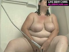 Kinky brunette girl goes horny and nasty in the shower. She soaps her body all over moving seductively. Sophie also masturbates with the shower head. Check out this hot solo masturbation video presented to you by ALL BBW CAMS.