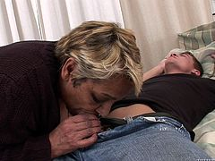 Watch out for your buckle, because granny Evrika is hungry for cock! This dude was laying on his back, when our horny grandma stepped in. She took out his dick and then, greedily started to suck him. She loved how his cock tasted like and then, rode it in reverse cowgirl position, for some jizz in her snatch.