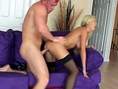 Busty blonde pornstar Nikki Benz with stockings and long hair fucked doggystyle and missionary when she was just starting out. She gets cum in mouth.