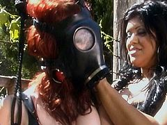 Babes in leather costumes are having a good time together in outdoor femdom scene