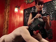 Redhead whore Madeline knows how properly, to punish a man. She bent this one and tied a rope on his leather mask. The bitch started to ass fuck him, with her strap on dildo and pulled the rope. He likes being in control and she's good at it. Will she go deeper and rougher on him? Let's find out!