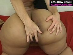 Nasty black bitch with fat round ass and juicy jugs lies on her back spreading her legs apart. White thirsty dude eats and fingers her clam. Later in a clip she sucks his dick deepthroat and gets fucked missionary style.