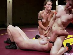 The match is rough and intense, just the way we like it here at Ultimate Surrender. Naked lesbians wrestle hard and the hot referee does her job flawless, well maybe she misses a few dirty moves. Soon everything gets a bit more complicated as in the arena the match goes two on one. This slut doesn't have a chance!