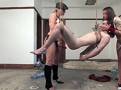 Nomad has fucked a few cunts in his life and always disrespected them, but this time Harmony and Penny are about to teach him a lesson! The girls tied him up, pulled down his pants and hung him. He hangs there immobilized and the bitches strap on their dildos and show this guy what it's like to be a cheap slut.