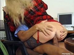 Kinky blonde slut Candy wearing black stockings is having fun with some guy in an office. She pleases the dude with a hot blowjob, then takes his shaft into her butt and jumps on it.