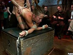 Brunette babe gets tied up and fisted. Then she also gets whipped and fucked hard. Everything happens in public.