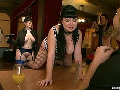 Luscious brunette in fishnet stockings gets toyed and fingered at a brunch. Later on she gets hanged up upside down and humiliated.