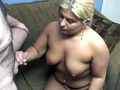 Blonde slut with chunky body has got saggy natural boobs. She is sitting naked before the guy while sucking his dick deepthroat. She works her mouth properly.