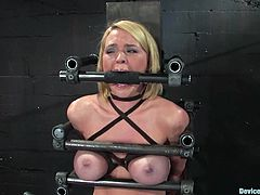 Charming blonde Krissy Lynn loves to play dirty games. She lets some guy chain her in a basement and enjoys getting her cunt toyed.