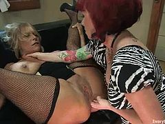 Two dirty minded and lusty lesbian milfs are in action. Debi and Kylie are so fucking in love with each other's twats and they love doing some dirty things to each other!
