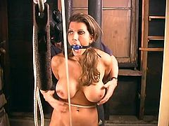 Curvaceous brunette girl gets tied up and gagged. Later on he massages her big boobs and toys the pussy.