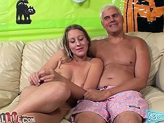 Nasty girl Lizzy London is playing dirty games on a sofa. She rubs her pussy with a dildo and then allows some nerd to please her with fingering and cunnilingus.