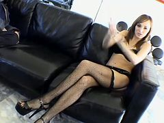 Brown-haired petite hottie Charlie Lane wearing sexy fishnet stockings is giving an interview indoors. She tells about her job and looks so hot.