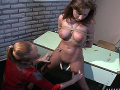 Busty college slut gets her big tits squeezed in rough BDSM way