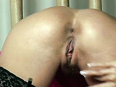 Gitta Szoke with giant boobs and bald bush fucks herself like mad in solo action