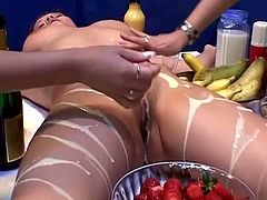 So, one babe is laying on the table, being surrounded with fruits and creams. Chicks stick bananas in their pussies and it reminds them of a huge cock!