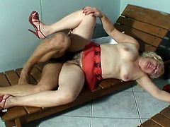 Nasty blonde granny gives a blowjob and then gapes her old vagina. After that she also gets her bushy pussy fucked hard.