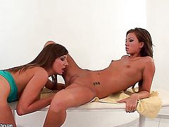 Brunette Natalia Forrest is in the mood for pussy eating and does it with lesbian Cate Harrington