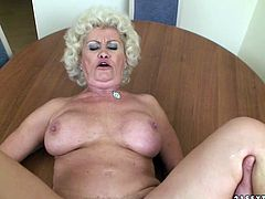 This old woman has a huge sexual appetite. Horny stud fucks her twat in and out making her big tits shake from side to side.