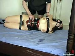 Brunette girl in a corset gets tied up and gagged by the man in a mask. After that Serena gets whipped and clothespinned.