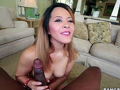 Petite bodied brunette girl with cute face and sweet smile takes massive black dong in her mouth. She sucks dick frantically.