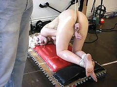 Blonde girl in red stockings and a corset gets tied up by her master. This babe also gets suspended high above the floor.