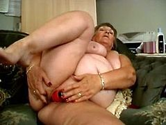 Big busty woman is feeling very horny so because she don't have anybody who will fuck her, she satisfies herself with her sex toys