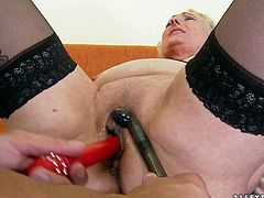 Insatiable granny is in the mood for a throbbing sex toy today. She asks her lover to tickle her snatch with her favorite sex toy. Then she pleases him with a blowjob.