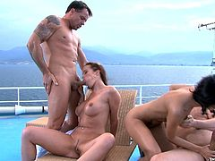 Two slim chicks get fucked by two guys on a cruise ship