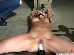 This lusty and super sexy babe Natalia is so fucking hungry for pain. So she gets hogtied and bent over for some penetration and spraying!