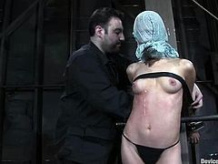 Kinky blonde girl gets tied up with straps and then humiliated. The tortures her tits with different devices and puts a gag in her mouth.