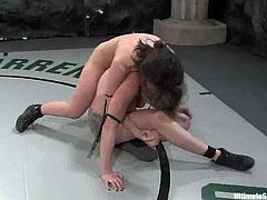 Devi Lynne loses a fight to Adrianna Nicole. That is why she has to lick Adrianna's vagina. Then the blonde girl pounds the brunette with a strap-on.