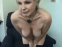 A busty blonde granny is trying to prove that she is still good at giving blowjobs. She kneels in front of a black hunk and drives him mad with a great blowjob.