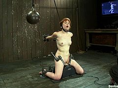 Cute redhead girl Juliette March lets some nerd bind and pinch her in a basement. Then she sits down on a fucking machine and enjoys a few minutes of dirty pleasure.