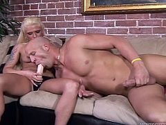 Bald dude Christian XXX is getting naughty with lewd blonde Monroe Valentino. Monroe face-fucks Christian with a strapon and then smashes his butt in missionary position.
