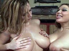 Two very busty babes are fucking in ffm mode