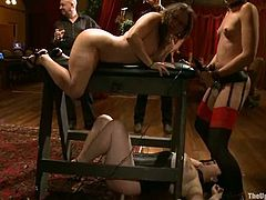 Dylan Ryan is getting punished by Maestro Stefanos and his friends at a banquet. The men chain Dylan into a pillory and whip her ass before pounding her cunt deep and hard.