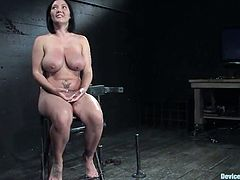 Bosomy brunette Claire Dames lets some guy put her into irons in a basement. She gets her tits squeezed with iron bars while the dude is rubbing her coochie with a dildo.